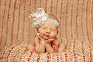Newborn baby girl in feathered headband Photo credit Refuge Photography in Frisco, TX