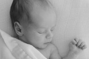 Sleeping black and white image of baby Eliot