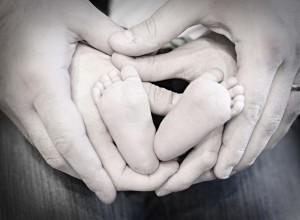 Mommy and Daddy's hands and baby's feet, photo credit Chelcie Guerra