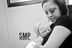 Kirsten cuddling baby Levi, photo credit Stefani Marcus Photography